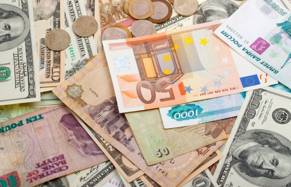 different currencies world money - Spur Magazine