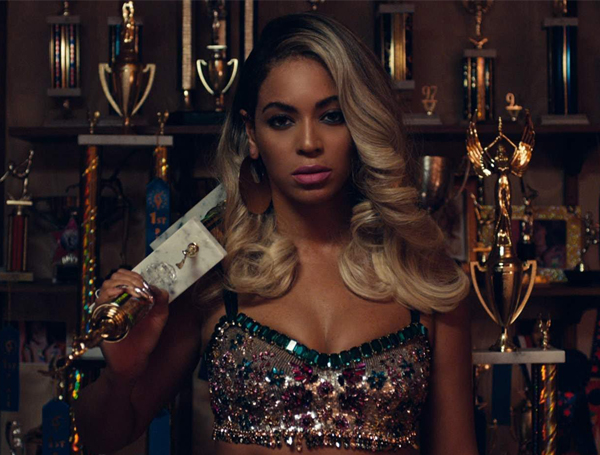 Beyonce Standing infront of trophies Pretty Hurts - Spur Magazine