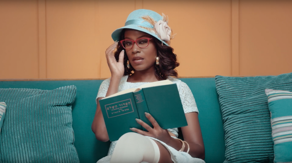 Juliana Kanyomozi Reading Hebrew Book in Im Still Here Music Video - Spur Magazine