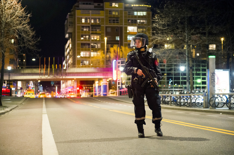 Police Officer stands guard in Oslo Norway after incident - Spur Magazine