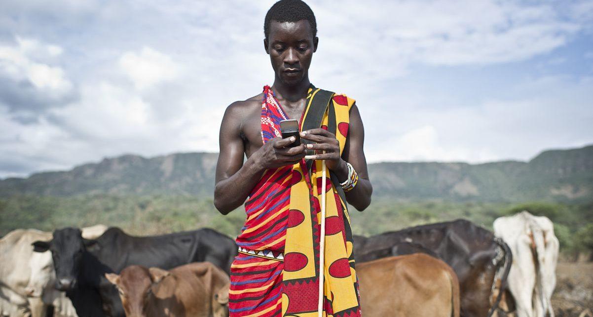 Masai man holding smartphone.