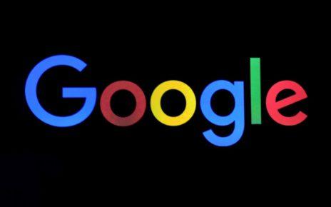 Google Logo behind black background.