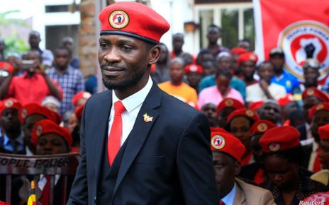 Bobi Wine with his supporters wearing red beret.